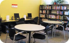 The career resource library in the Career Centre's lobby, with computers, tables, and books.