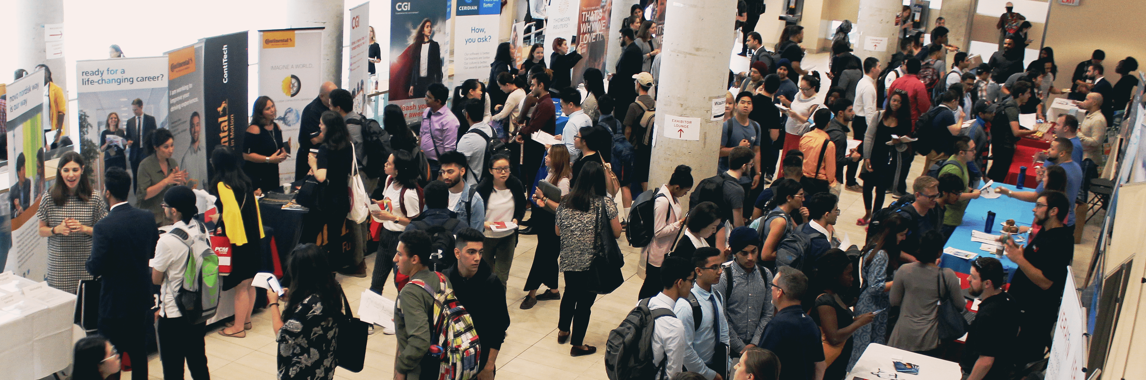 Picture shows people networking in a job fair setting